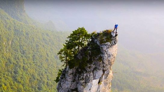 Rock Climber on a Chinese Karst Mountain