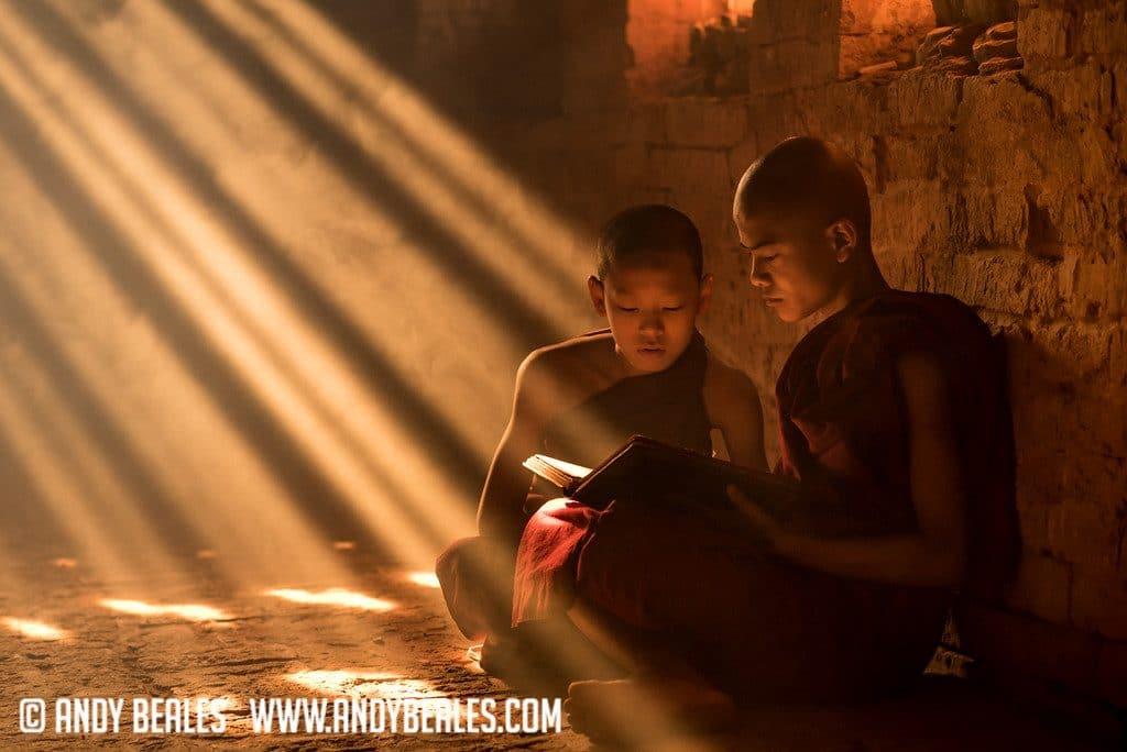 Monks reading inside a Burmese temple of Myanmar