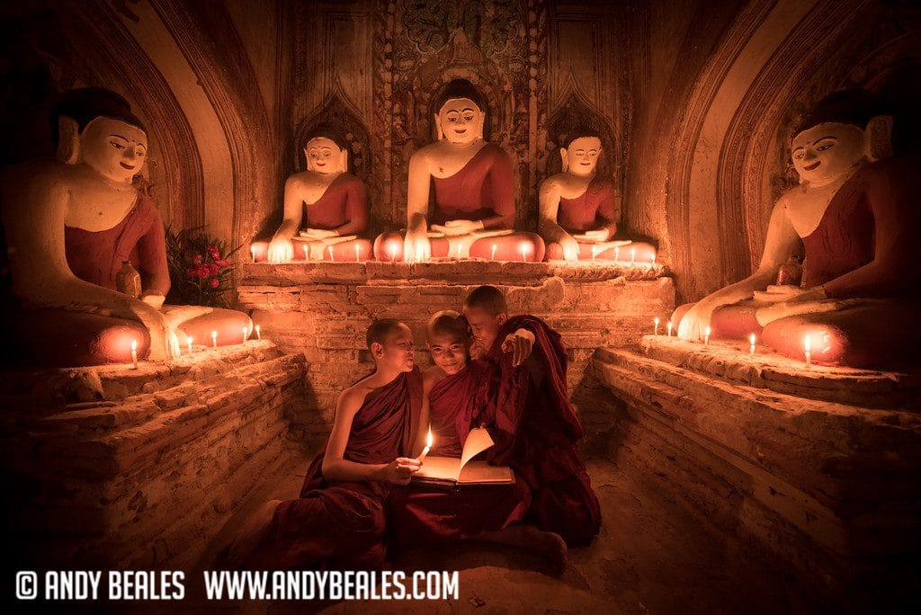 Three Teenage Monks in a laughing in a temple in Myanmar
