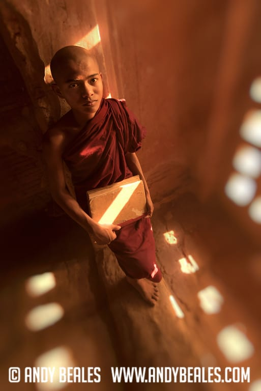 14 Year old monk in Burma waits by the wall