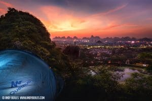 Guilin city sunset from chuanshan park with a tent in the foreground