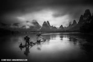 Guilin cormorant fisherman braves a storm