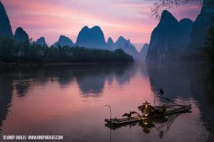 Guilin cormorant fishermen puts out his kerosine lamp on Guilin's Li River, China.