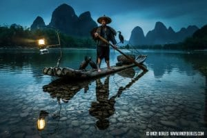 A Guilin cormorant fisherman returns home by kerosine lamp on the Li River in Guilin, China.