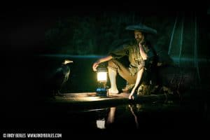 A cormorant fisherman night fishing in Guilin China by lamp light